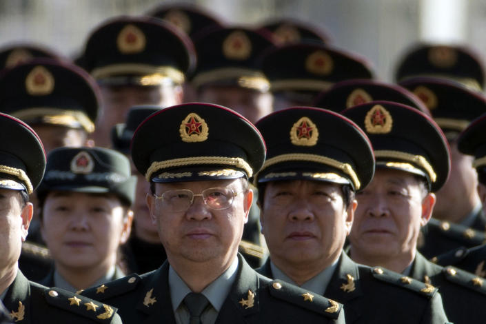 Delegates from China's People's Liberation Army (PLA) march from Tiananmen Square to the Great Hall of the People to attend sessions of National People's Congress and Chinese People's Political Consultative Conference in Beijing, China, Tuesday, March 4, 2014. (AP Photo/Ng Han Guan)