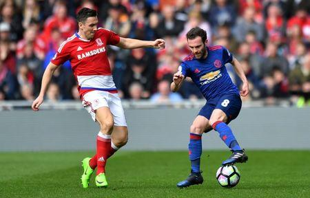 Manchester United's Juan Mata in action with Middlesbrough's Stewart Downing