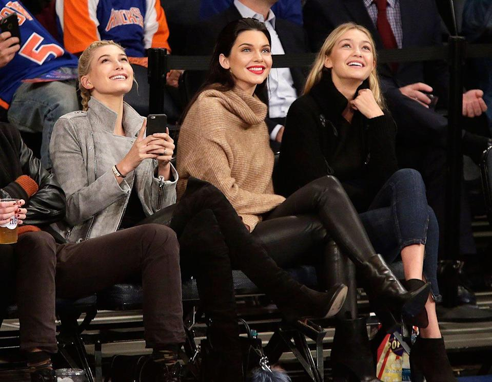 <p>Hanging out with fellow models Hailey Baldwin and Gigi Hadid in a pair of Helmut Lang leather trousers at a basketball game in Madison Square Garden, October 2014.</p>