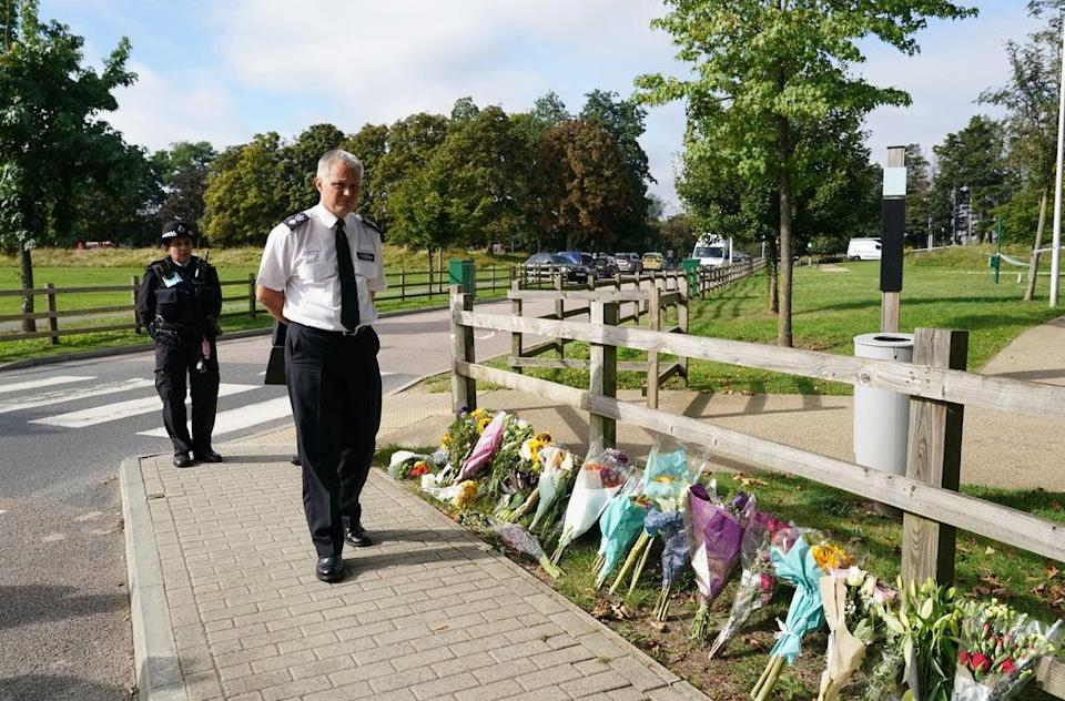 Chief Superintendent Trevor Lawry by the floral tributes near where the body of Sabina Nessa was found (PA)