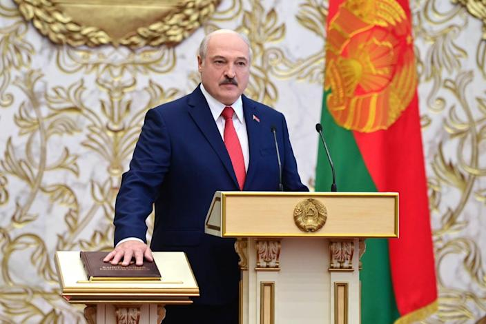 "<span class=""caption"">Belarusian president Alexander Lukashenko takes the oath of office during an unannounced inauguration ceremony Sept. 23 in Minsk.</span> <span class=""attribution""><a class=""link rapid-noclick-resp"" href=""https://www.gettyimages.com/detail/news-photo/belarus-president-elect-alexander-lukashenko-takes-oath-of-news-photo/1228665640?adppopup=true&uiloc=thumbnail_more_search_results_adp"" rel=""nofollow noopener"" target=""_blank"" data-ylk=""slk:Andrei Stasevich\TASS via Getty Images"">Andrei Stasevich\TASS via Getty Images</a></span>"