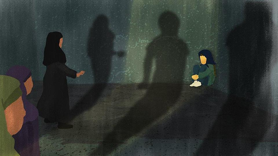 Three women approach a frightened girl, who is sitting in a ball in the corner of a dark room. Their shadows appear menacing.