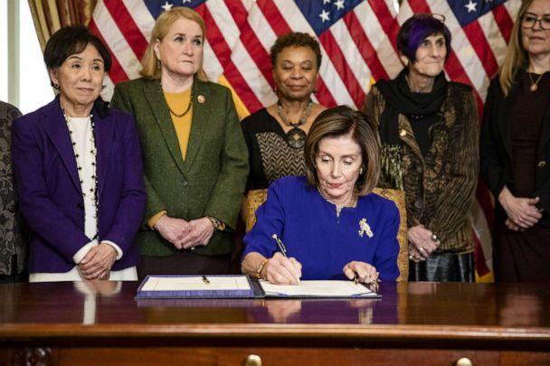 PHOTO: House Majority Leader Nancy Pelosi, D-Calif., signs the Coronavirus Emergency Response Package which passed the House with only three votes against it on Capitol Hill on March 5, 2020, in Washington, D.C. (Samuel Corum/Getty Images)