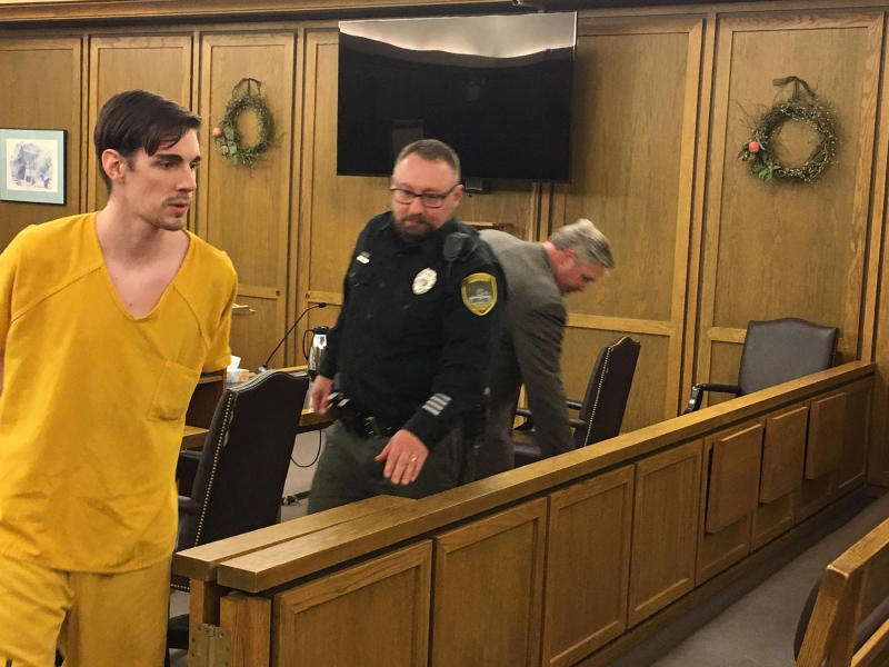 In this Friday, April 19, 2019, John A. Radavich, 24, left, is led back to jail after a hearing before Superior Court Judge Maryann Moreno in Spokane, Wash. The discovery of new evidence prompted a judge to declare a mistrial in the murder case against Radavich charged with killing the nephew of U.S. Sen. Jon Tester of Montana. The Spokesman-Review reports Friday, April 19, 2019, that court records show a sheriff's detective found a text message in the file while preparing to give testimony that hadn't been turned over to the defense. A new trial is set for August. (Thomas Clouse/The Spokesman-Review via AP, File)