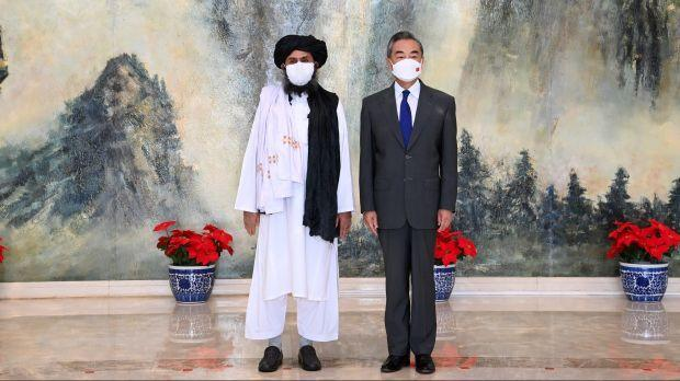 Chinese State Councilor and Foreign Minister Wang Yi meets with Mullah Abdul Ghani Baradar, political chief of Afghanistan's Taliban, in Tianjin, China July 28, 2021. Picture taken July 28, 2021. Li Ran/Xinhua via REUTERS