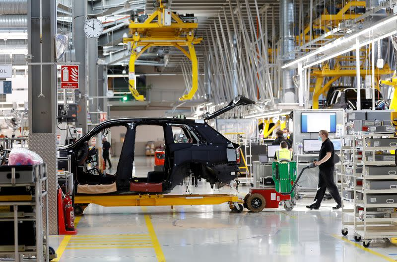 FILE PHOTO: A technician moves the body of a Rolls-Royce Cullinan on the production line of the Rolls-Royce Goodwood factory, near Chichester