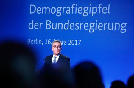 German Interior Minister Thomas de Maiziere gives a speech at the demographic summit in Berlin