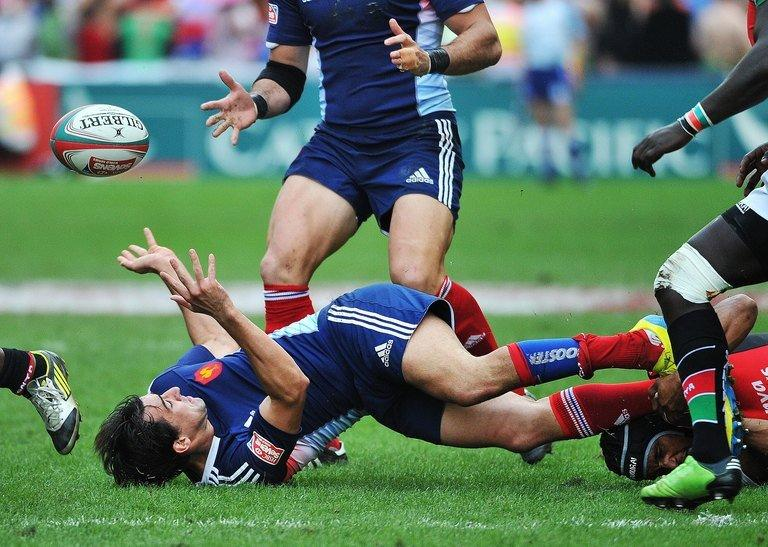 Kenya's Biko Adema (bottom-R) tackles France's Paul Albaladejo during the Hong Kong Rugby Sevens, on March 23, 2013