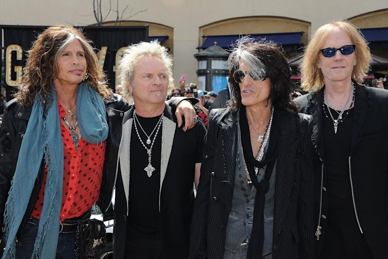 Steven Tyler, from left, Joey Kramer, Joe Perry, and Tom Hamilton of Aerosmith, pose for pictures at the Aerosmith news conference announcing the 2012 Global Warming Tour, Wednesday, March 28, 2012, at The Grove, in Los Angeles. The Global Warming Tour will play 18 markets beginning on June 16, in Minneapolis. (AP Photo/Katy Winn)