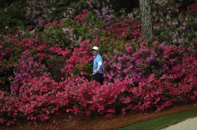 Rory McIlroy of Northern Ireland looks back at the green while hitting out from amid the azaleas on the 13th hole during third round play of the 2018 Masters golf tournament at the Augusta National Golf Club in Augusta, Georgia, U.S. April 7, 2018. REUTERS/Mike Segar
