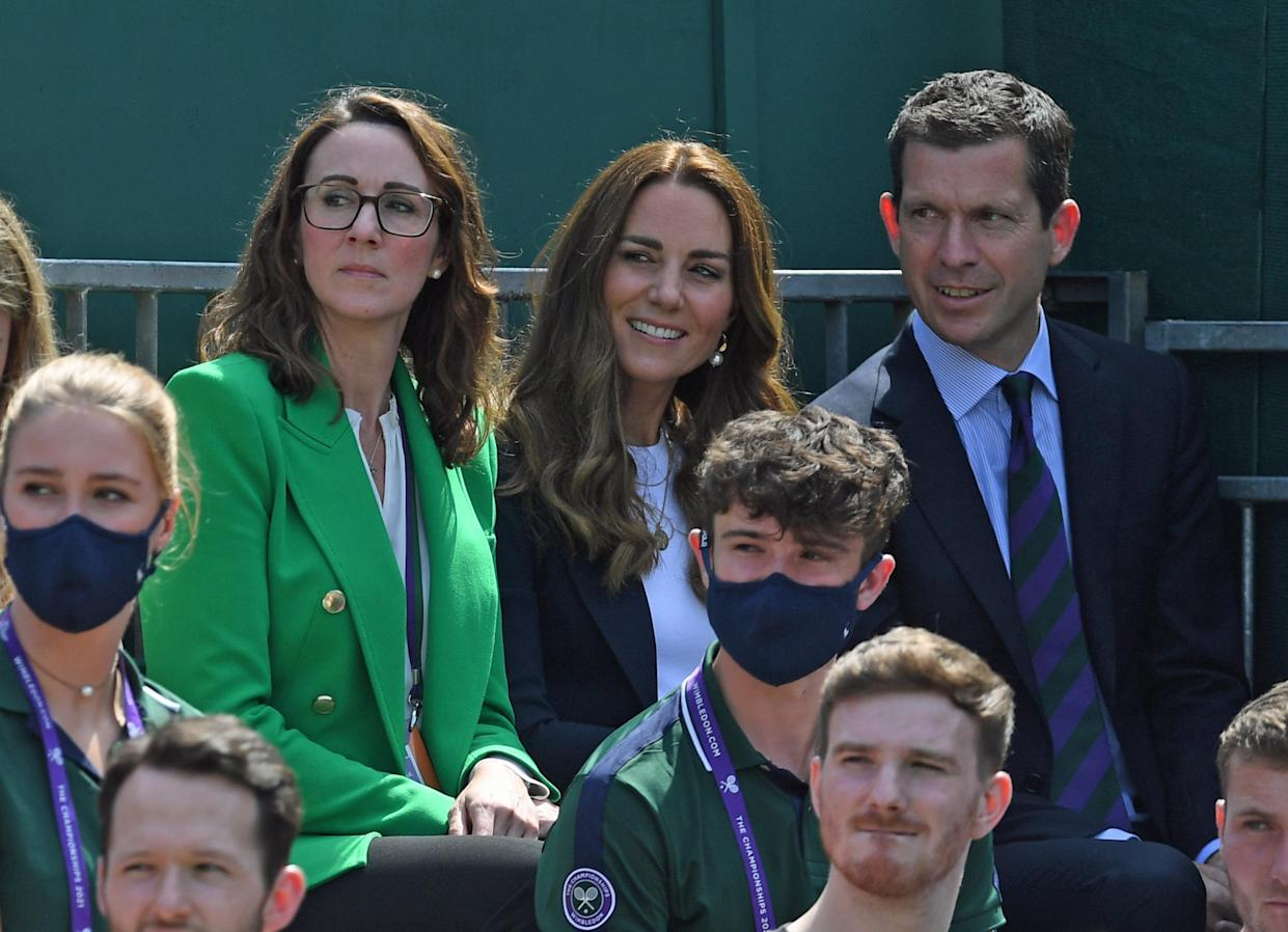 The Duchess of Cambridge and Tim Henman (right) attending day five of Wimbledon at The All England Lawn Tennis and Croquet Club, Wimbledon.