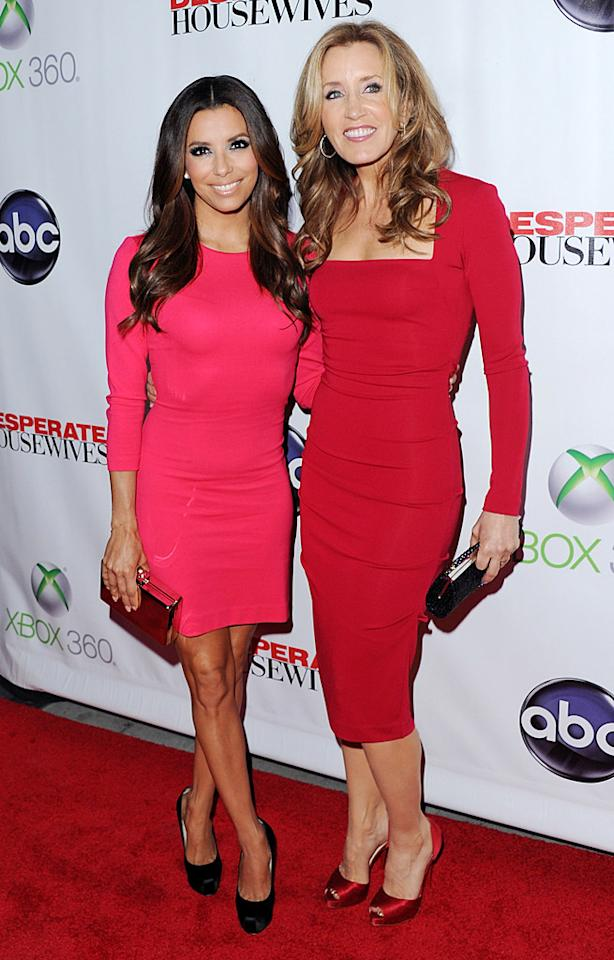 """Desperate Housewives"" may be coming to a close, but two of its stars -- Eva Longoria and Felicity Huffman -- don't look like they've aged a day since shooting commenced eight years ago. At the show's series finale party, which was held at the W Hollywood, Longoria rocked a hot pink Ann Taylor dress and Brian Atwood pumps, while Huffman sported an even sexier Nicole Miller jewel-toned dress and ruby red peep-toes. (4/29/2012)"