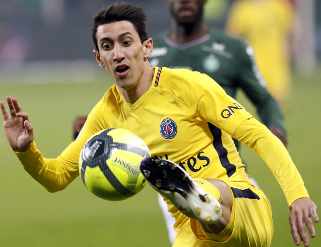 FILE - In this Friday, April 6, 2018 file photo, PSG's Angel Di Maria controls the ball during the French League One soccer match between Saint-Etienne and Paris Saint Germain, in Saint-Etienne, central France. Angel Di Maria is still angry at being left out of PSGs biggest game of the season, back in February 2018. The Argentina winger does not know if he will stay at the club, given the French champion is under pressure to sell players. (AP Photo/Laurent Cipriani, File)