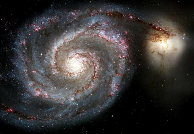 A new view of the Whirlpool Galaxy, one of the two largest and sharpest images Hubble Space Telescope has ever taken, is released by NASA on Hubble's 15th anniversary April 25, 2005. The new Whirlpool Galaxy image showcases the spiral galaxy's curving arms where newborn stars reside and its yellowish central core that serves as home for older stars. During the 15 years Hubble has orbited the Earth, it has taken more than 700,000 photos of the cosmos. (CREDIT : REUTERS/NASA/Handout)