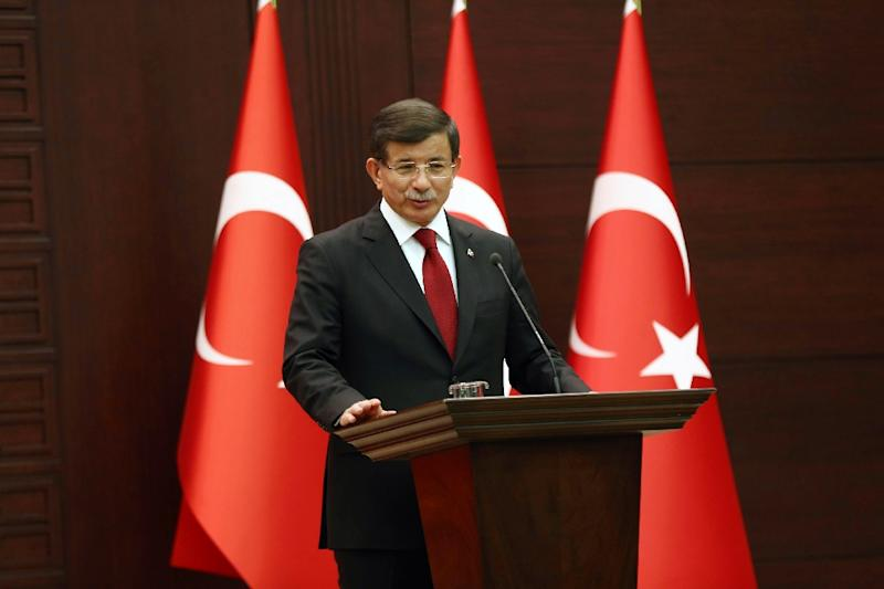 Turkish Prime Minister Ahmet Davutoglu speaks in Ankara on November 24, 2015 after announcing a new cabinet (AFP Photo/Adem Altan)