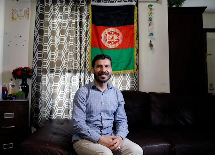 Shamsurahman Zaland poses for a photo in his apartment in Dublin on June 7, 2021. Zaland, a refugee from Afghanistan, came here in 2018 with a Special Immigrant Visa for his work with the U.S. government.