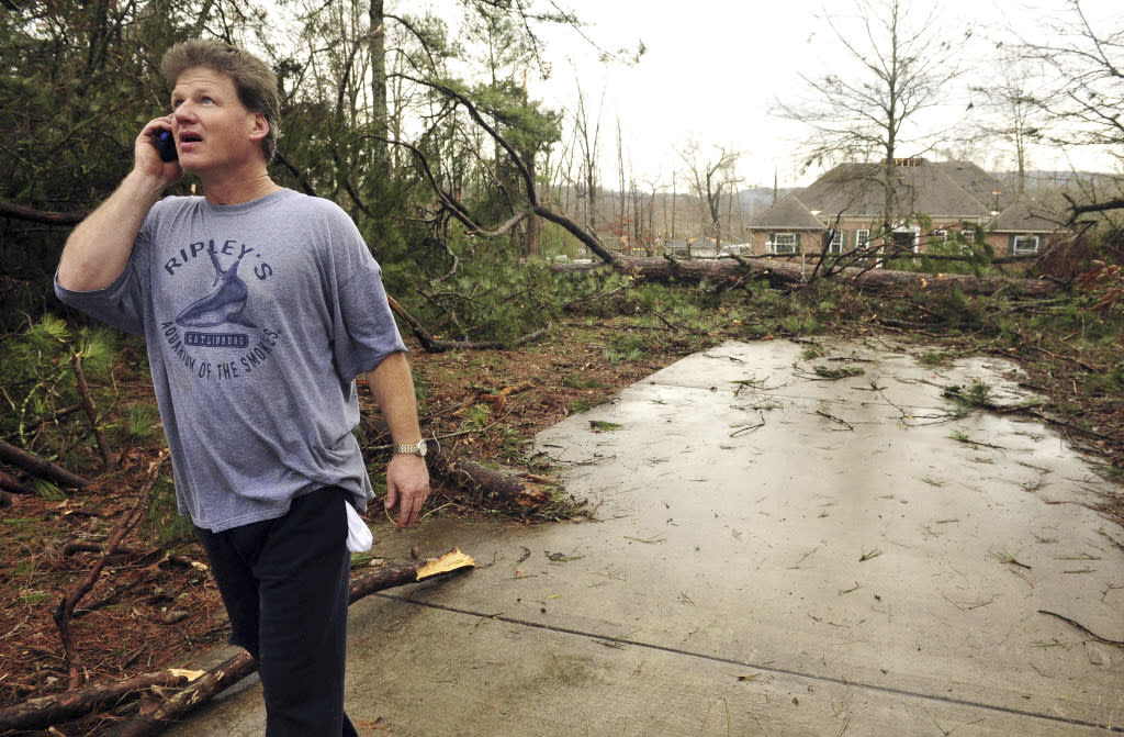 Steven Curet talks to family members and describes the damage after severe weather hit the northern part of Madison county Friday, March 2, 2012 in Huntsville, Ala.  A reported tornado destroyed several houses in northern Alabama as storms threatened more twisters across the region Friday  (AP Photo/The Huntsville Times, Eric Schultz)