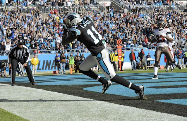 Carolina Panthers' Brandon LaFell (11) catches a touchdown pass as Tampa Bay Buccaneers' Mark Barron (23) looks on in the first half of an NFL football game in Charlotte, N.C., Sunday, Dec. 1, 2013. (AP Photo/Mike McCarn)