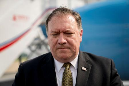 FILE PHOTO: U.S. Secretary of State Mike Pompeo pauses while speaking to members of the media before boarding his plane at Sunan International Airport in Pyongyang
