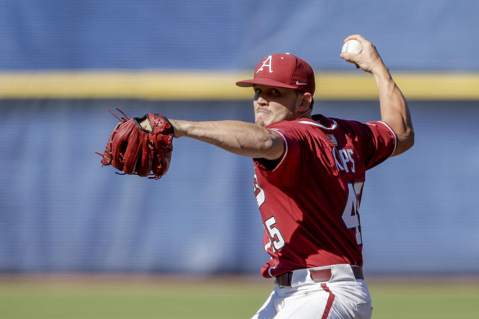 Arkansas pitcher Kevin Kopps pitches against Tennessee in the ninth inning of an NCAA college baseball championship game during the Southeastern Conference tournament Sunday, May 30, 2021, in Hoover, Ala. (AP Photo/Butch Dill)