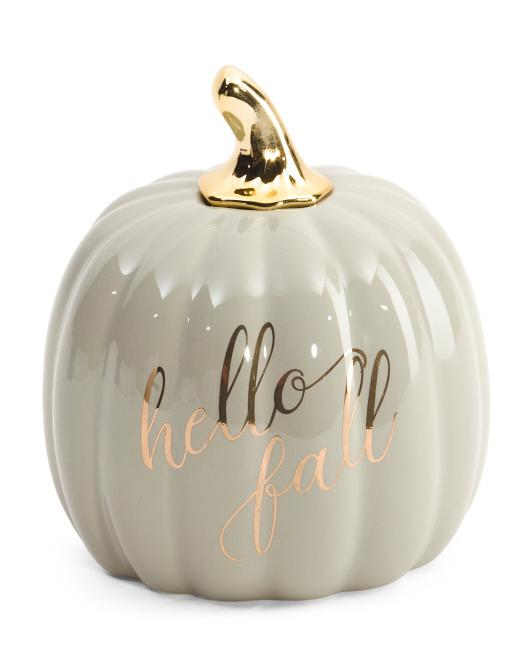 white ceramic pumpkin with a gold stem and gold writing that says hello fall from tj maxx