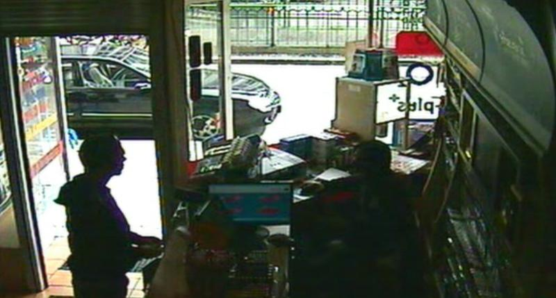 """This image taken from CCTV obtained by Associated Press video shows Luka Rocco Magnotta speaking to Kadir Anlayisli, a cafe worker who recognized him, in the Internet cafe in the district of Neukoelln in Berlin, Germany, Monday, June 4, 2012. """"I looked at him and thought I knew him from somewhere, because I read newspapers every day,"""" Anlayisli said. Luka Rocco Magnotta was apprehended on Monday in an Internet cafe in Berlin after an employee there recognized him and alerted police, Berlin police spokeswoman Kerstin Ziesmer said. The 29-year-old Canadian porn actor is accused of videotaping a killing and mailing the victim's body parts to the country's top political parties. (AP Photo/AP Video)"""