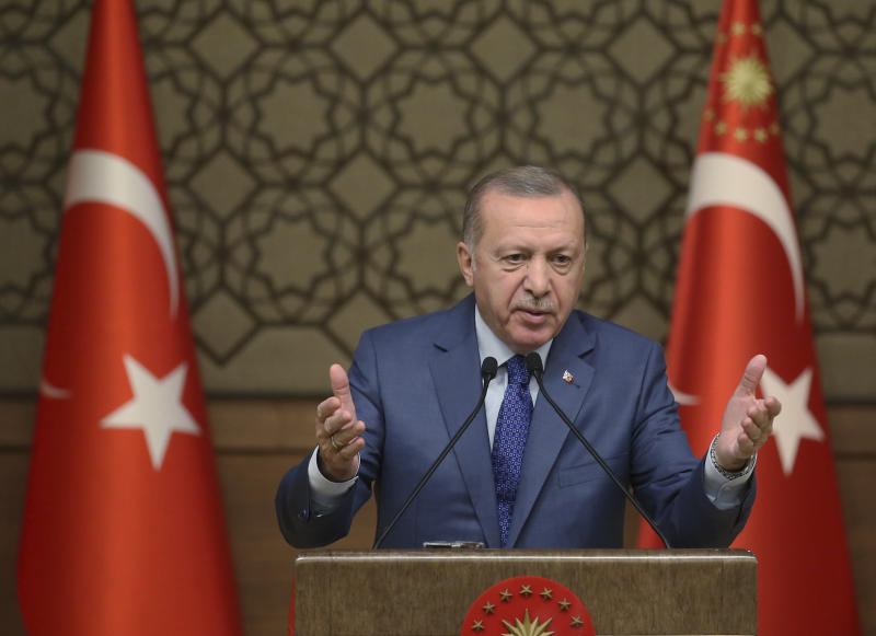 "Turkish President Recep Tayyip Erdogan speaks during a meeting at his presidential palace, in Ankara, Turkey, Thursday, Oct. 24, 2019. Erdogan on Thursday renewed a threat to resume its military offensive if his country continued to be ""harassed"" by the Kurdish militia.( Presidential Press Service via AP, Pool )"
