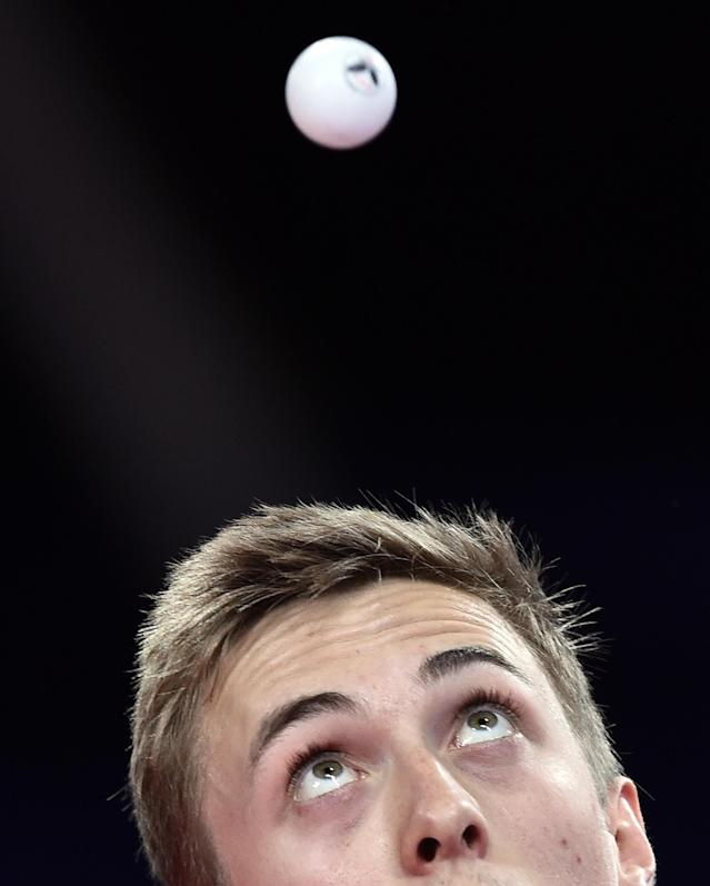 England's Liam Pitchford serves a ball at a match in the Scotstoun Sports Campus during the Commonwealth Games in Glasgow on July 28, 2014 (AFP Photo/Andrej Isakovic)