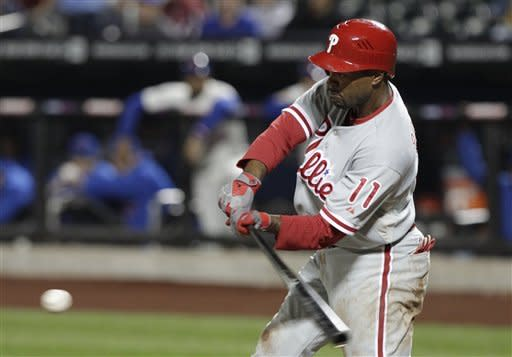 Philadelphia Phillies' Jimmy Rollins hits a two-run single during the first inning of a baseball game against the New York Mets on Thursday, Sept. 20, 2012, in New York. (AP Photo/Frank Franklin II)