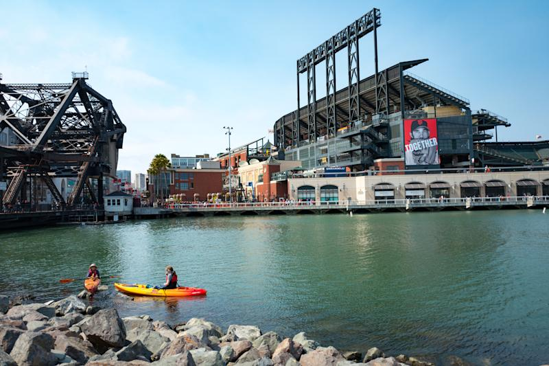 </a> Two kaykers paddle through McCovey Cove near ATT Park, the baseball stadium of the San Francisco Giants, in the China Basin neighborhood of San Francisco, California, August 21, 2016. Boats often gather in the cove during home games in hopes of catching homerun balls which have been hit out of the ballpark and into the waters of the cove, San Francisco, California. (Photo by Smith Collection/Gado/Getty Images).Smith Collection/Gado Getty Images