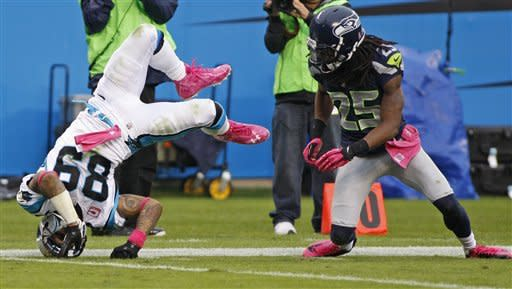 Carolina Panthers' Steve Smith (89) flips after missing a catch against Seattle Seahawks' Richard Sherman (25) during the third quarter of an NFL football game in Charlotte, N.C., Sunday, Oct. 7, 2012. (AP Photo/Nell Redmond)