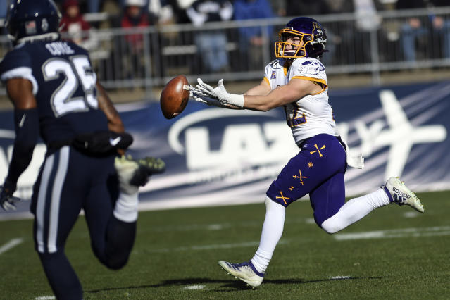 East Carolina wide receiver Tyler Snead (22) misses a pass during the first half of an NCAA college football game against Connecticut Saturday, Nov. 23, 2019, in East Hartford, Conn. (AP Photo/Stephen Dunn)