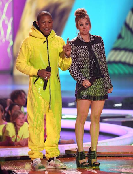 Pharrell Williams, left, and Kaley Cuoco present the award for favorite female singer at the 27th annual Kids' Choice Awards at the Galen Center on Saturday, March 29, 2014, in Los Angeles. (Photo by Matt Sayles/Invision/AP)
