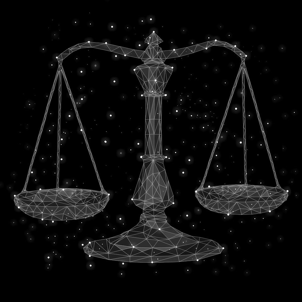 A vector drawing of the Libra scales of justice with stars dotted in the background