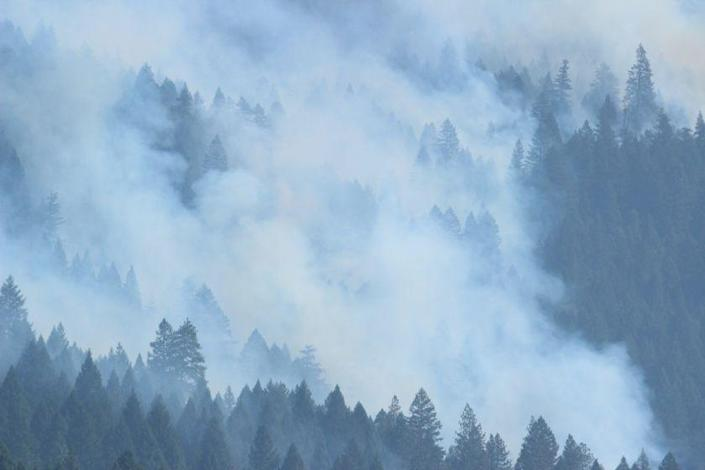 Smoke hovers over the forest amid the August Complex fire, on Sept. 22, 2020