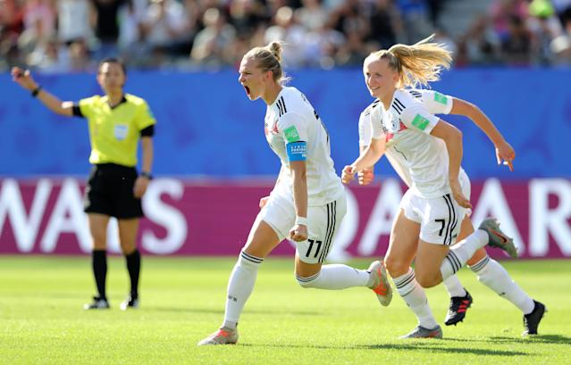 Alexandra Popp (11) celebrates after scoring Germany's first goal against Nigeria on Saturday. (Getty)