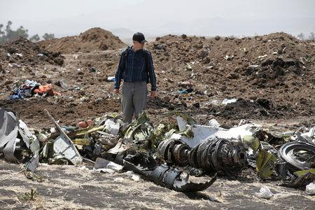 FILE PHOTO: American civil aviation and Boeing investigators search through the debris at the scene of the Ethiopian Airlines Flight ET 302 plane crash, near the town of Bishoftu, southeast of Addis Ababa