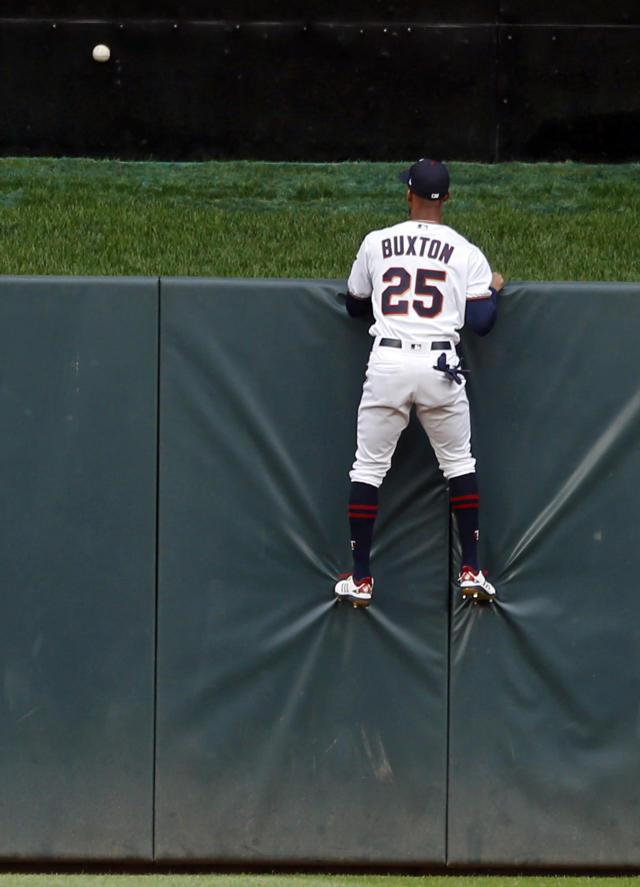 Minnesota Twins' center fielder Byron Buxton gets a good view of the bouncing home run ball off the bat of Detroit Tigers' Nicholas Castellanos in the first inning of a baseball game Monday, May 21, 2018, in Minneapolis. (AP Photo/Jim Mone)