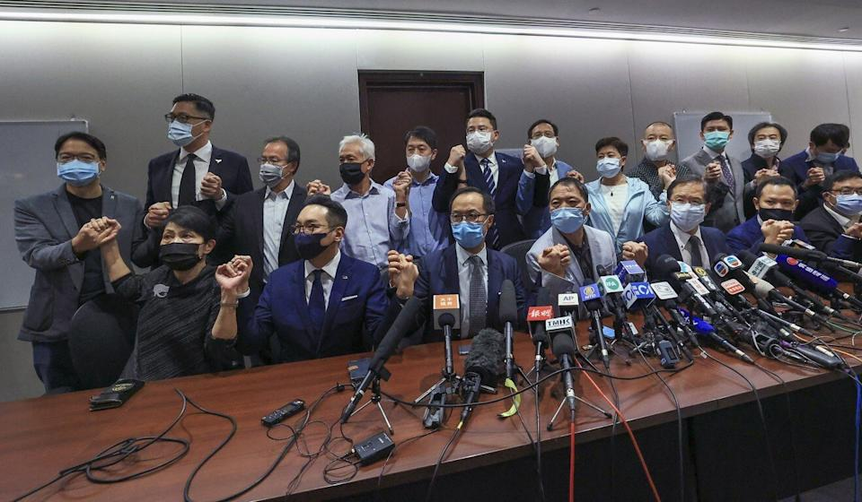 Opposition lawmakers pledge in a press conference at Legco on Wednesday to resign in protest against a recent resolution by Beijing. Photo: May Tse