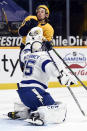 Tampa Bay Lightning goaltender Curtis McElhinney (35) pushes Nashville Predators left wing Erik Haula (56) out of the crease during the second period of an NHL hockey game Tuesday, April 13, 2021, in Nashville, Tenn. (AP Photo/Mark Zaleski)