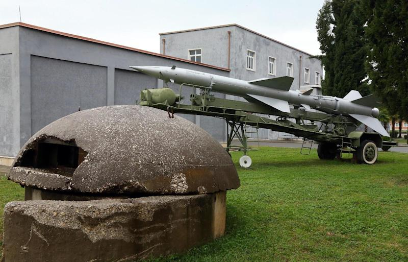 An old unused missile and a  bunker of the Albanian army are displayed at the Defense Ministry in the capital Tirana, Monday Nov. 28, 2016, for the celebrations of Independence Day. Albania joined NATO in 2009, and since then has been replacing outdated weaponry with the new ones in line with the alliance's standards. (AP Photo Hektor Pustina)