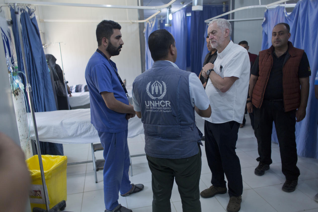 United Kingdom's Labour party leader Jeremy Corbyn inspects a primary health care center during his visit to the Zaatari Syrian Refugee Camp, in Mafraq, Jordan, Friday, June 22, 2018. (AP Photo/Nasser Nasser)