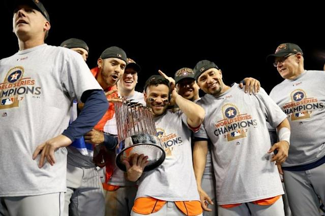 Houston Astros players celebrate after their scandal-tainted World Series victory in 2017 (AFP Photo/EZRA SHAW)