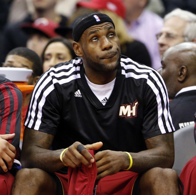 Miami Heat forward LeBron James (6) sits on the bench in the first half of an NBA basketball game against the Washington Wizards, Wednesday, Jan. 15, 2014, in Washington. The Wizards won 114-97. (AP Photo/Alex Brandon)