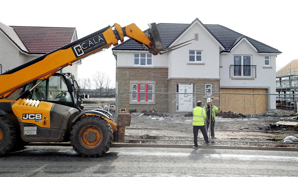 Workmen at CALA Homes West close their building site down in Larbert in Scotland on the day after Prime Minister Boris Johnson put the UK in lockdown, and First Minister Nicola Sturgeon called for construction sites to close, to help curb the spread of the coronavirus.