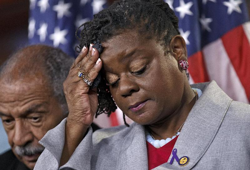 Rep. Gwen Moore, D-Wis., accompanied by Rep. John Conyers, D-Mich, pauses during a news conference on Capitol Hill in Washington, Wednesday, May 16, 2012, to push for the unrestricted reauthorization of the Violence Against Women Act. (AP Photo/J. Scott Applewhite)