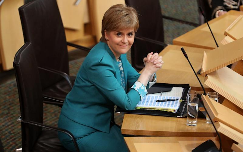 Nicola Sturgeon at First Minister's Questions at the Scottish Parliament - PA
