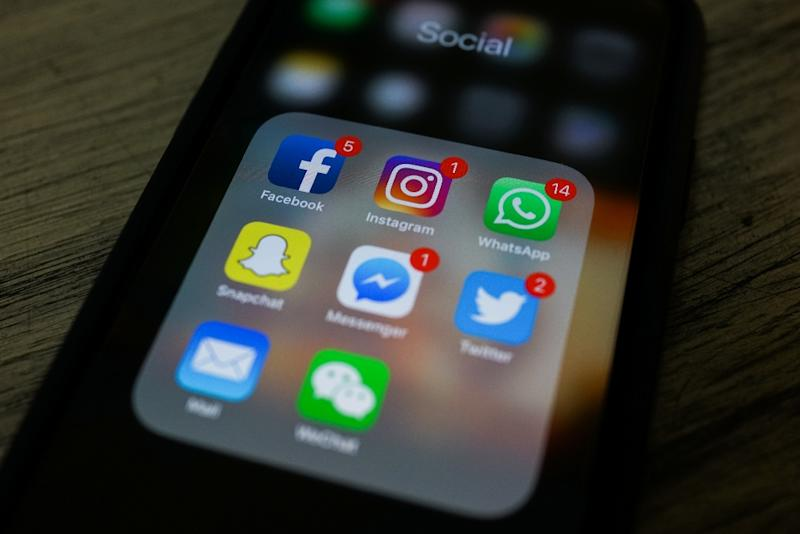 Under the law social networks would have to introduce measures allowing users to flag up false reports (AFP Photo/CHANDAN KHANNA)