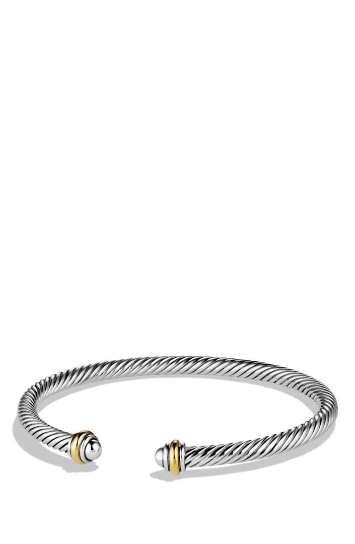 """<p><strong>David Yurman </strong></p><p>nordstrom.com</p><p><strong>$395.00</strong></p><p><a href=""""https://go.redirectingat.com?id=74968X1596630&url=https%3A%2F%2Fwww.nordstrom.com%2Fs%2Fdavid-yurman-cable-classics-bracelet-with-18k-gold-4mm%2F3625630&sref=https%3A%2F%2Fwww.townandcountrymag.com%2Fstyle%2Fbeauty-products%2Fg19408606%2Fgift-ideas-for-women%2F"""" rel=""""nofollow noopener"""" target=""""_blank"""" data-ylk=""""slk:Shop Now"""" class=""""link rapid-noclick-resp"""">Shop Now</a></p><p>Give her the gift of a bracelet that will simply never go out of style.</p>"""