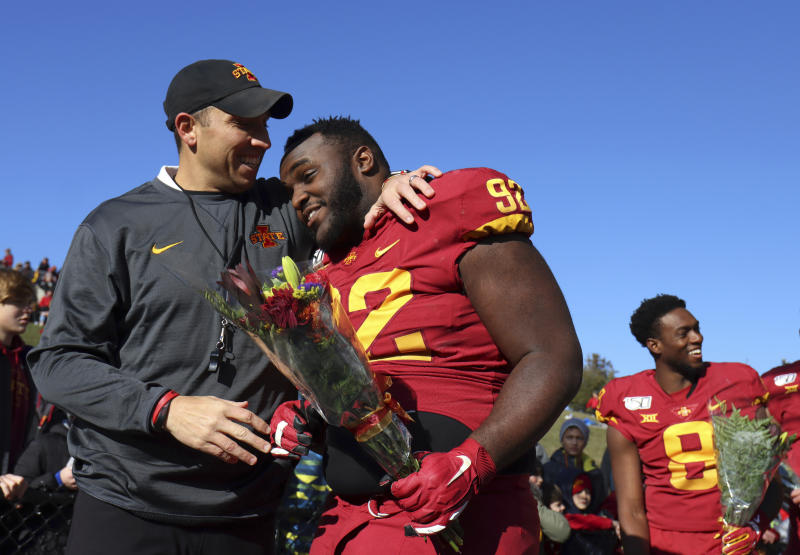 Iowa State head coach Matt Campbell, left, greets Iowa State defensive lineman Jamahl Johnson during senior day before an NCAA college football game against Kansas, Saturday, Nov. 23, 2019, in Ames, Iowa. (AP Photo/Matthew Putney)